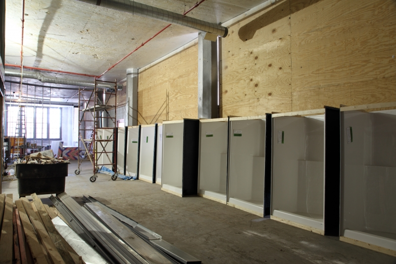 Shower stalls awaiting placement into the first housing units of 2320 Lofts  to be made available as early as December of this year  Photo by Dan Morgan. Tower Press Development launches 2320Lofts in Campus District